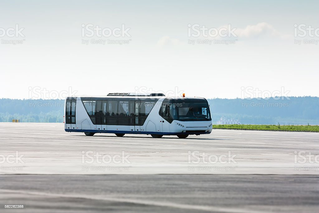 Airport bus on the taxiway stock photo