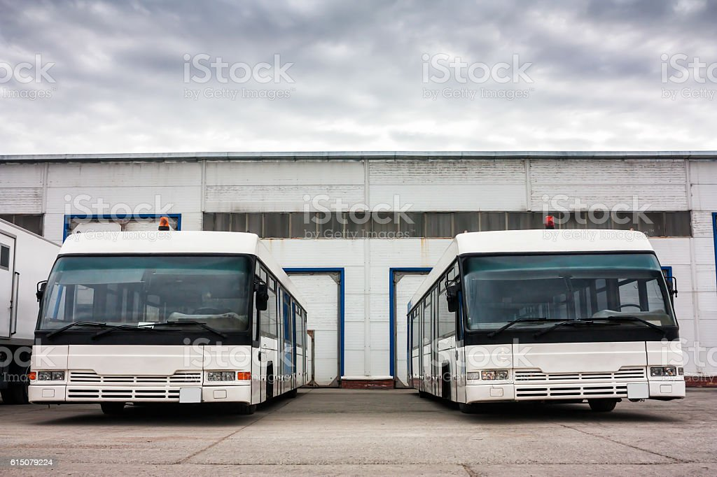 Airport buses in the parking lot near the garages royalty-free stock photo