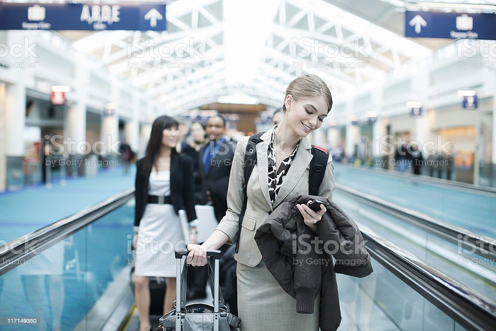 Airport Business Travel, Young Woman Checking Phone, Copy Space stock photo