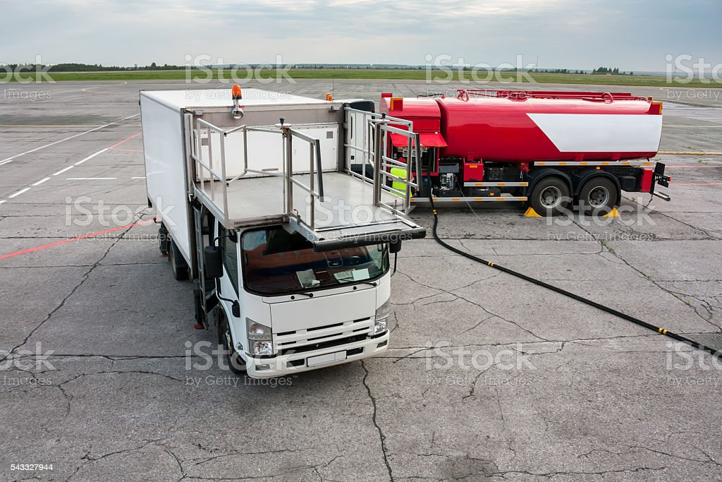 Airport catering truck and refueling truck on apron royalty-free stock photo