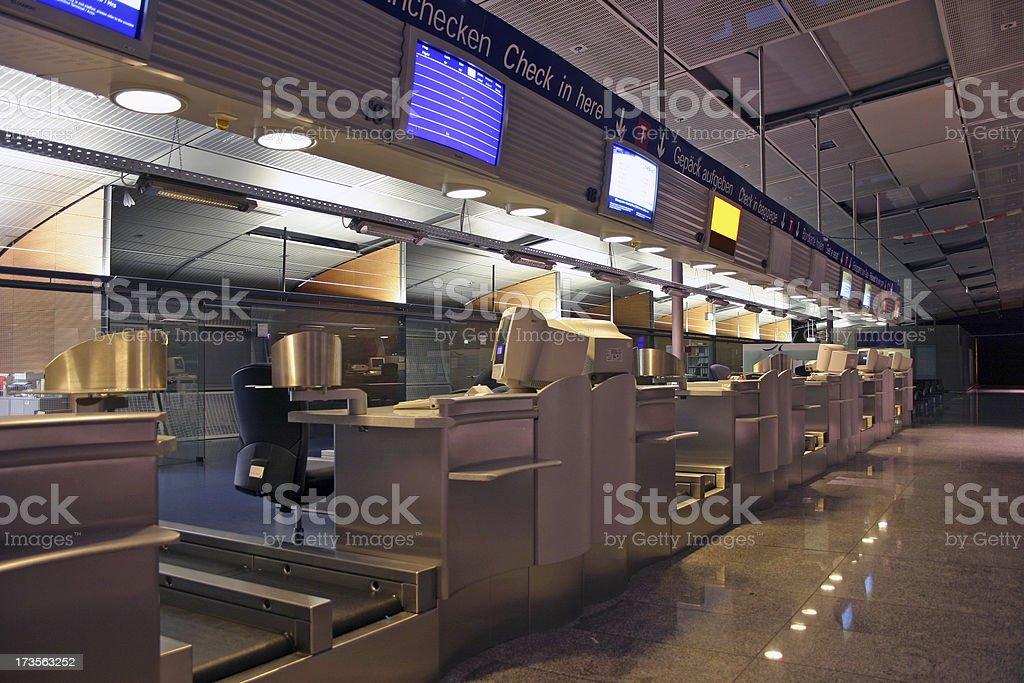 Airport checkin counters at night stock photo