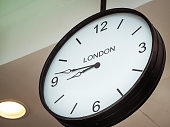Airport clock showing London time zone