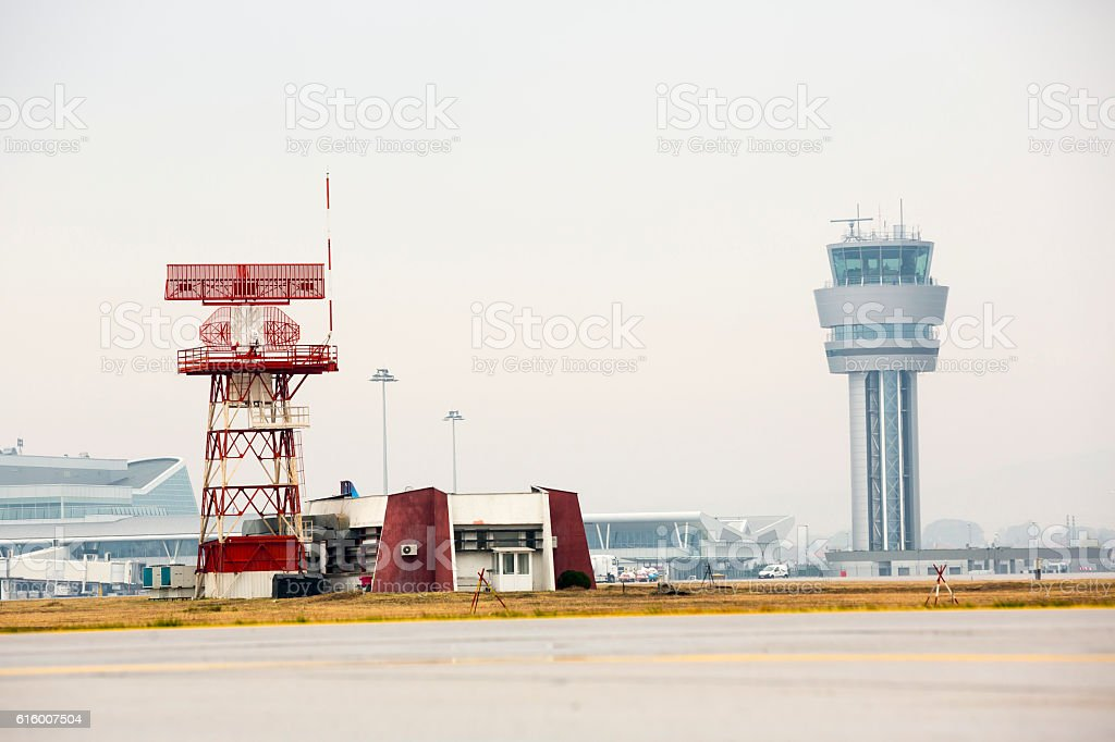 Airport control tower and radar communication tower stock photo