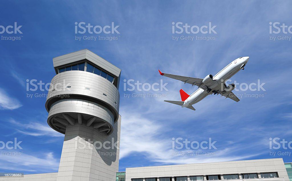Airport control tower, passenger airplane royalty-free stock photo