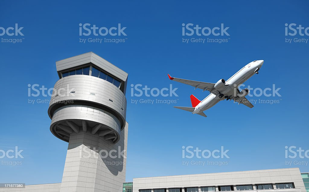 Airport control tower, passenger airplane stock photo
