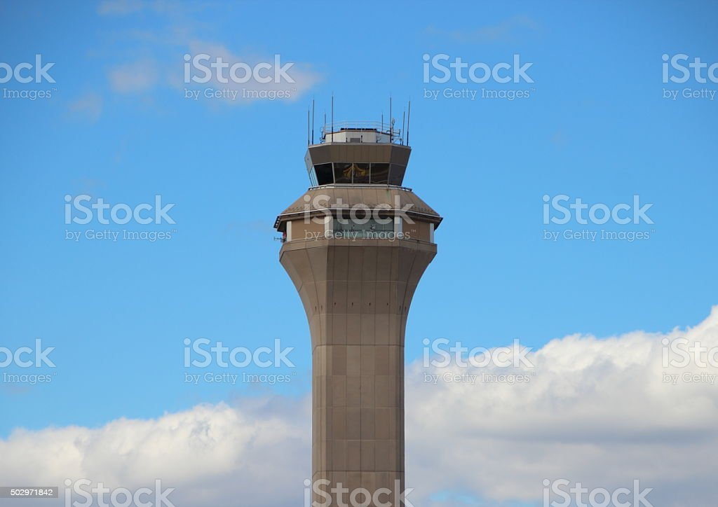 Airport Control Tower with Clouds and Blue Sky stock photo