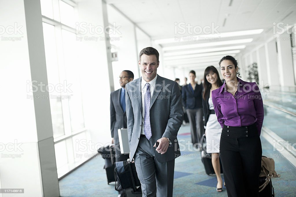 Airport, Coworkers Pulling Luggage on Business Travel,  Copy Space royalty-free stock photo