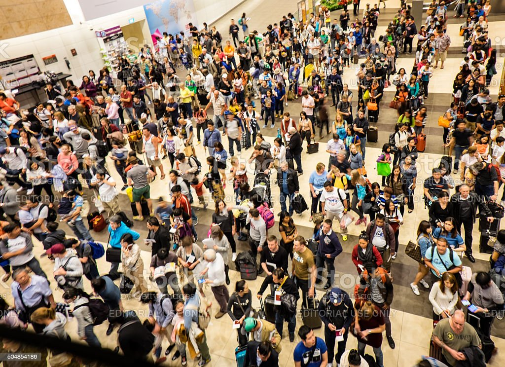 Airport Crowd at Singapore Changai Airport stock photo