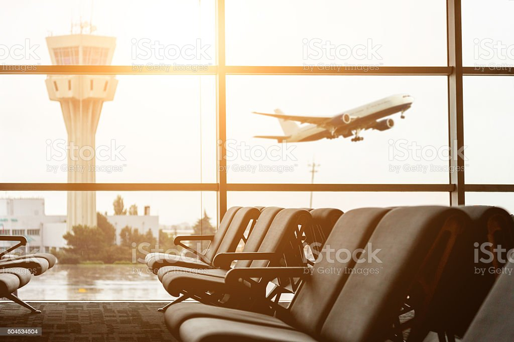 Airport departure all with control tower and airplane on backgro stock photo