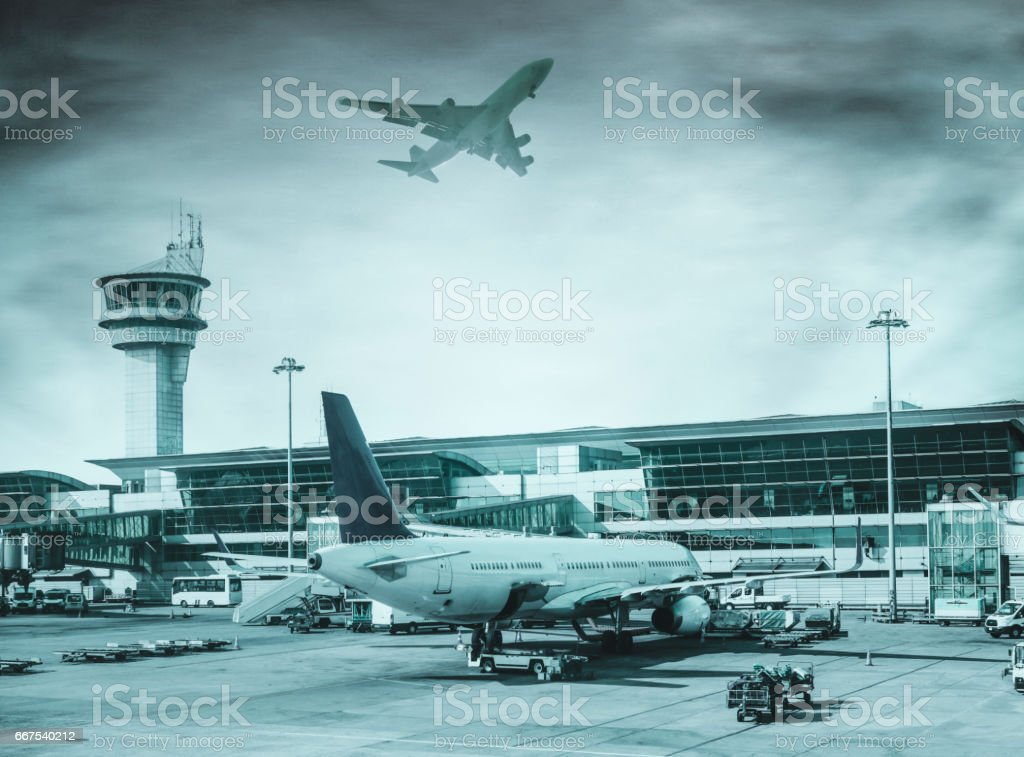 Airport departure all with control tower and airplane on background stock photo