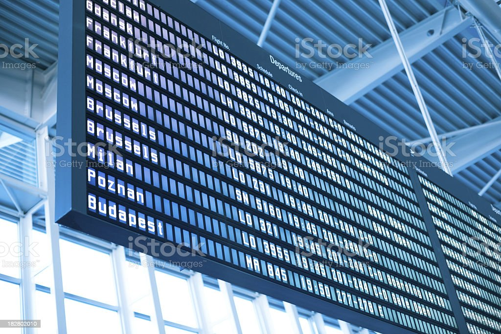 Airport departure board in blue tones royalty-free stock photo