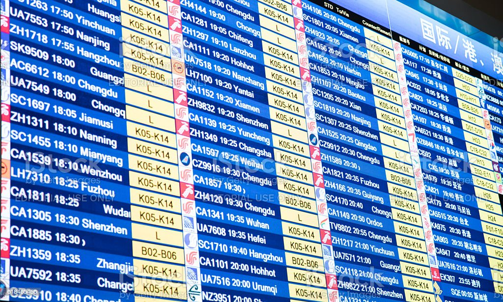 airport departure board with timetable of airliner flights stock photo