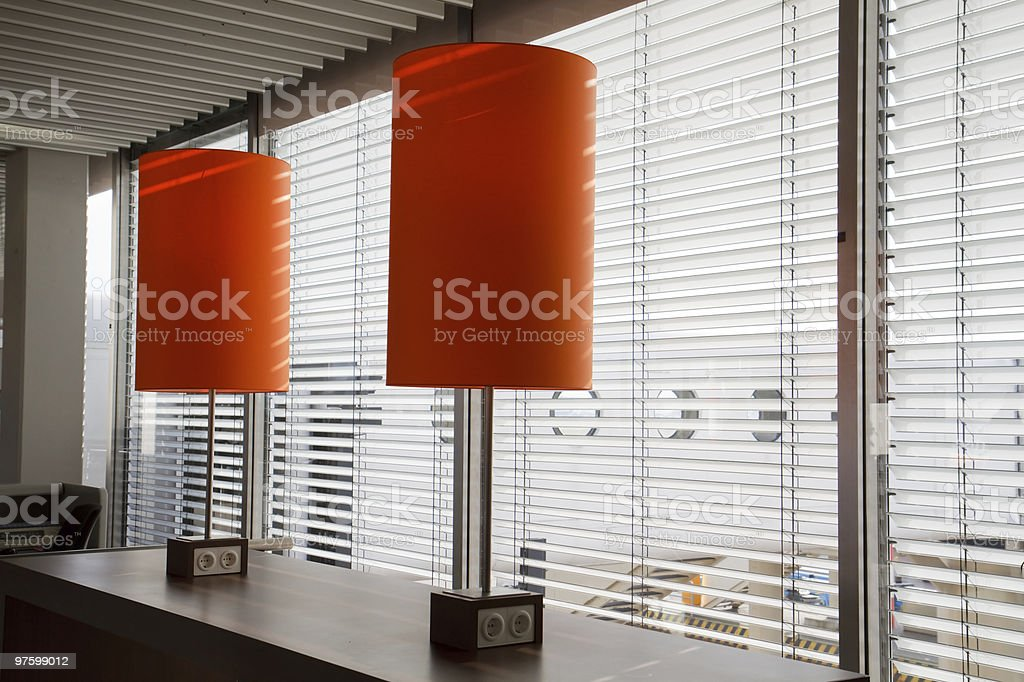 Airport desk with orange lamps royalty-free stock photo