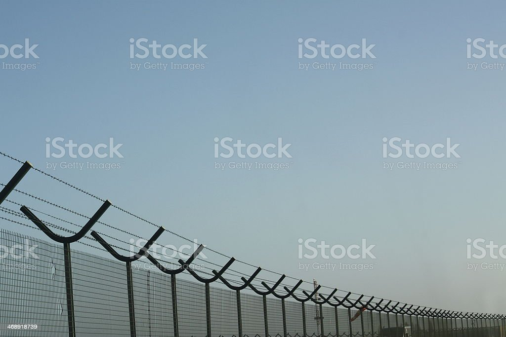 Airport fence stock photo