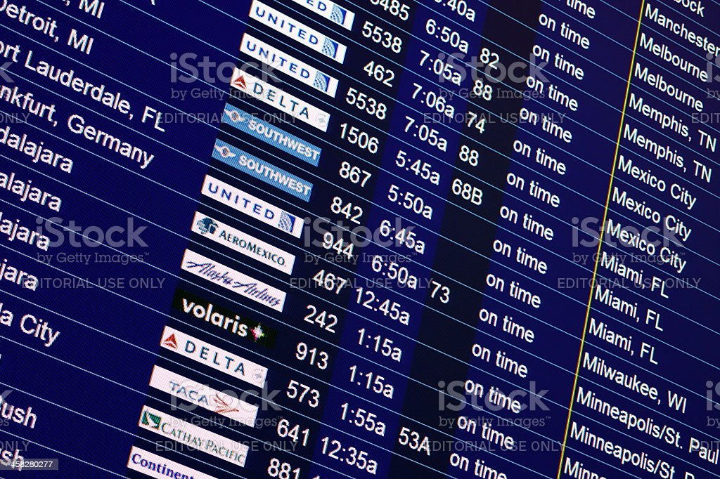 Airport flight schedule sign with airline names royalty-free stock photo