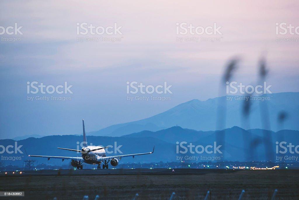 Airport in the nightfall stock photo