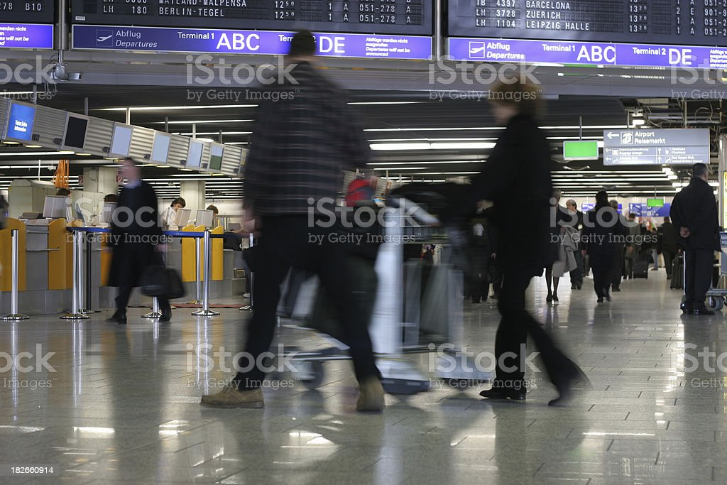 Airport life - passengers walking by royalty-free stock photo