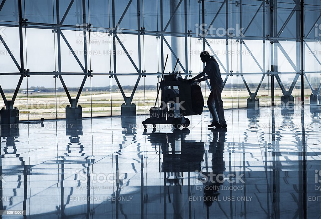 Airport lobby and cleaning staff stock photo