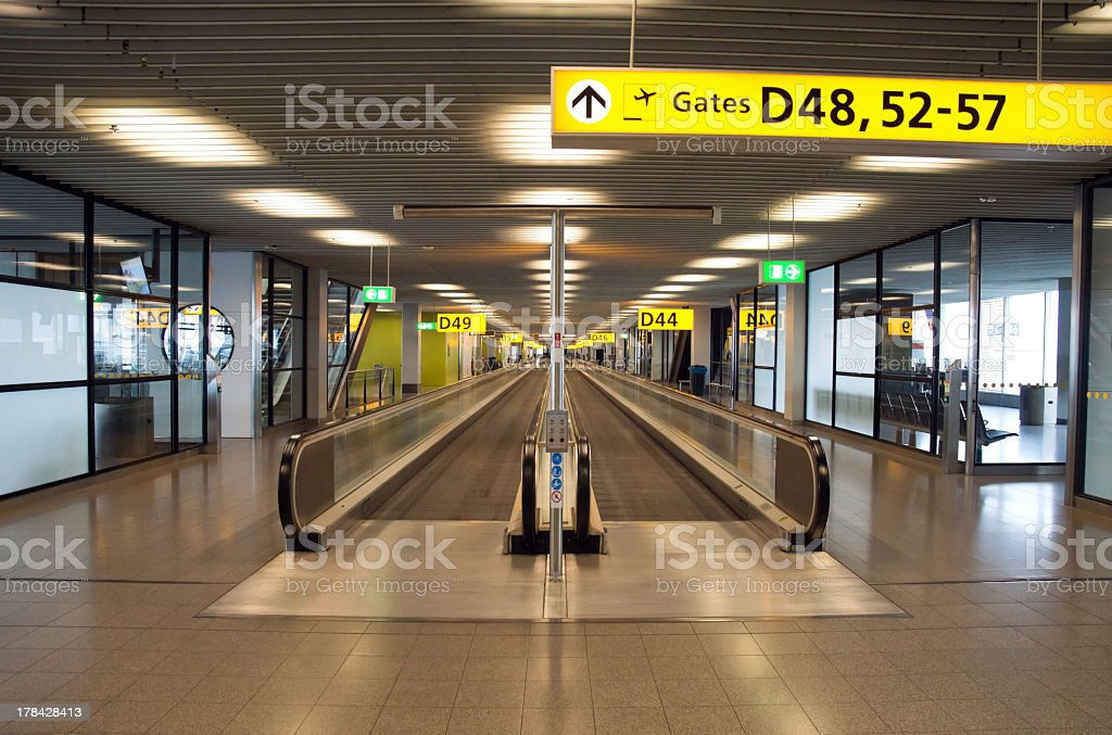 Airport lobby with a walking treadmill stock photo