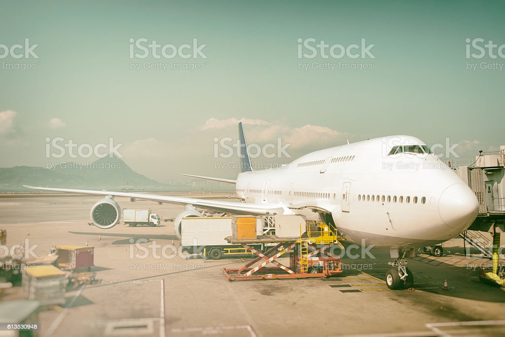 Airport Logistics Servicing Passenger Jet stock photo