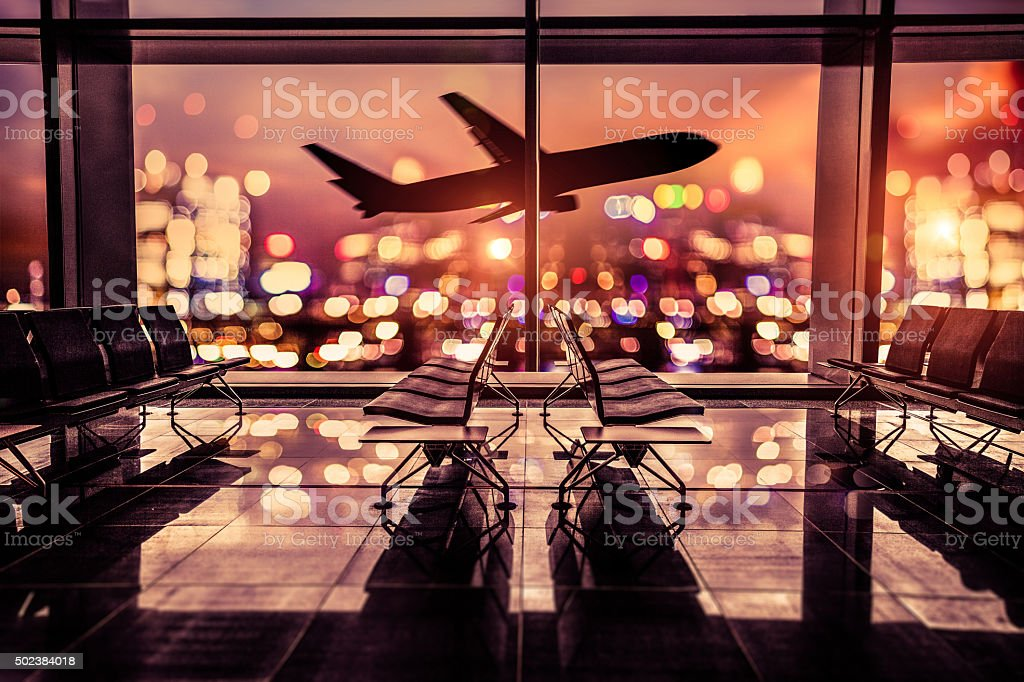 Airport Lounge and airplane take off in the city stock photo