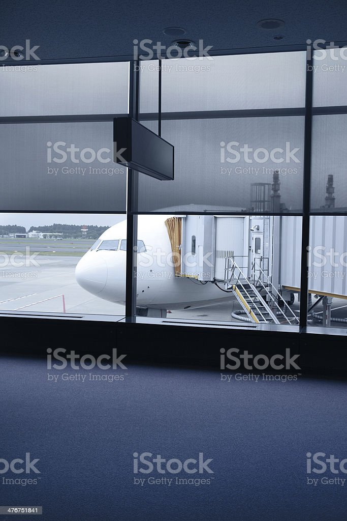 Airport lounge with docked airplane royalty-free stock photo