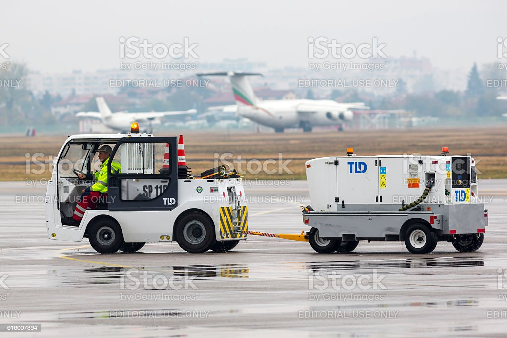 Airport luggage car stock photo