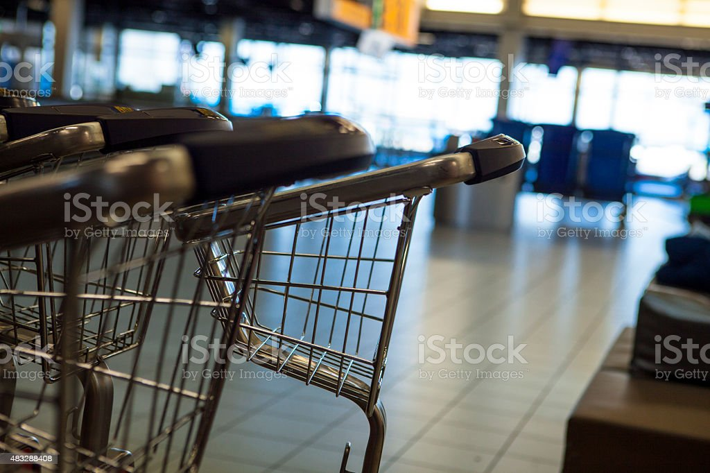 Airport luggage carts stock photo