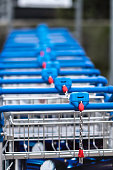 Airport luggage trolleys. Selective focus. Vertical shot