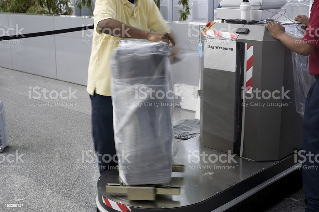 Airport Luggage Wrapping progress stock photo