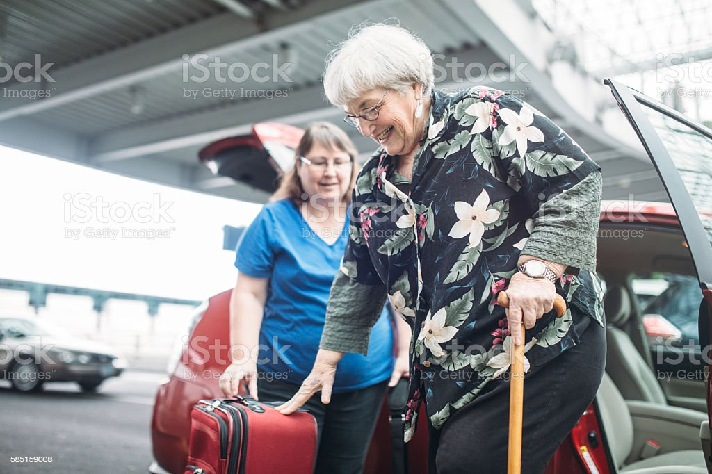 Airport Ride For Senior Woman stock photo