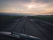 Airport runway at sunrise