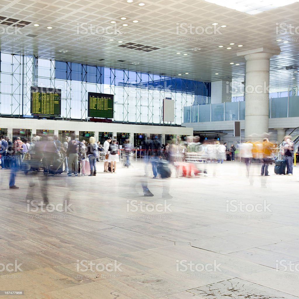 Airport Rush Travellers at the Check-In Counters stock photo