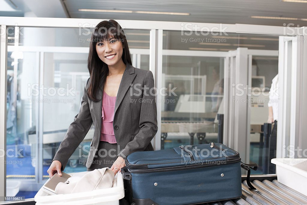 Airport Security, Asian Young Woman on Business Travel, Smiling stock photo