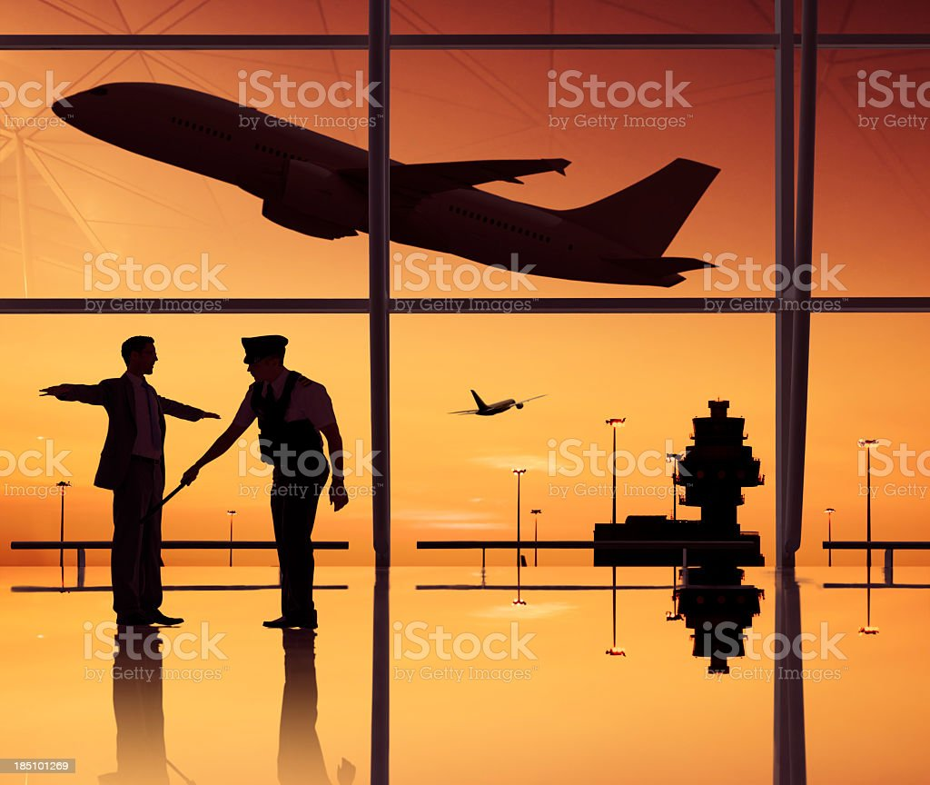 Airport security check with a plane taking off stock photo