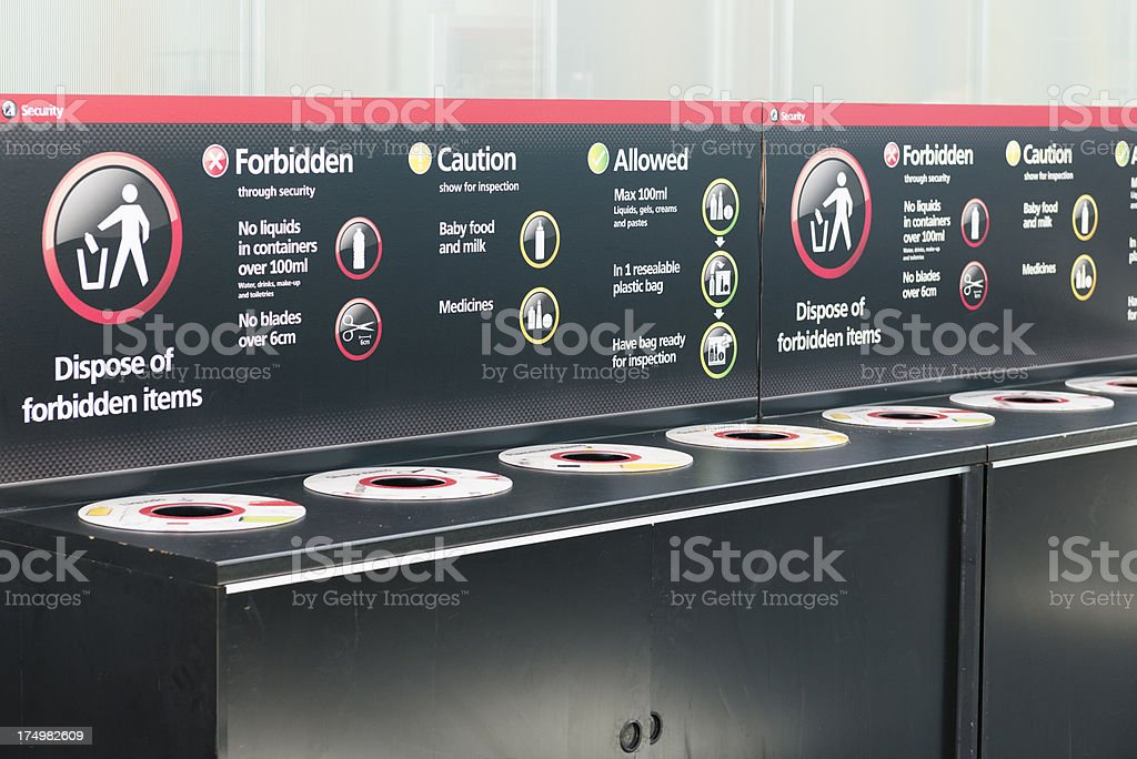 Airport security disposal bins for forbidden items stock photo