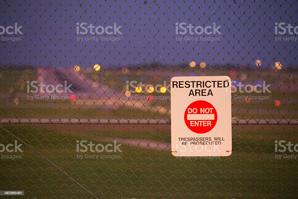 airport security fence stock photo