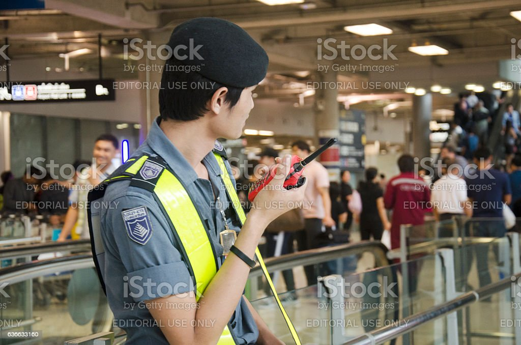 Airport Security Guard standing for security stock photo