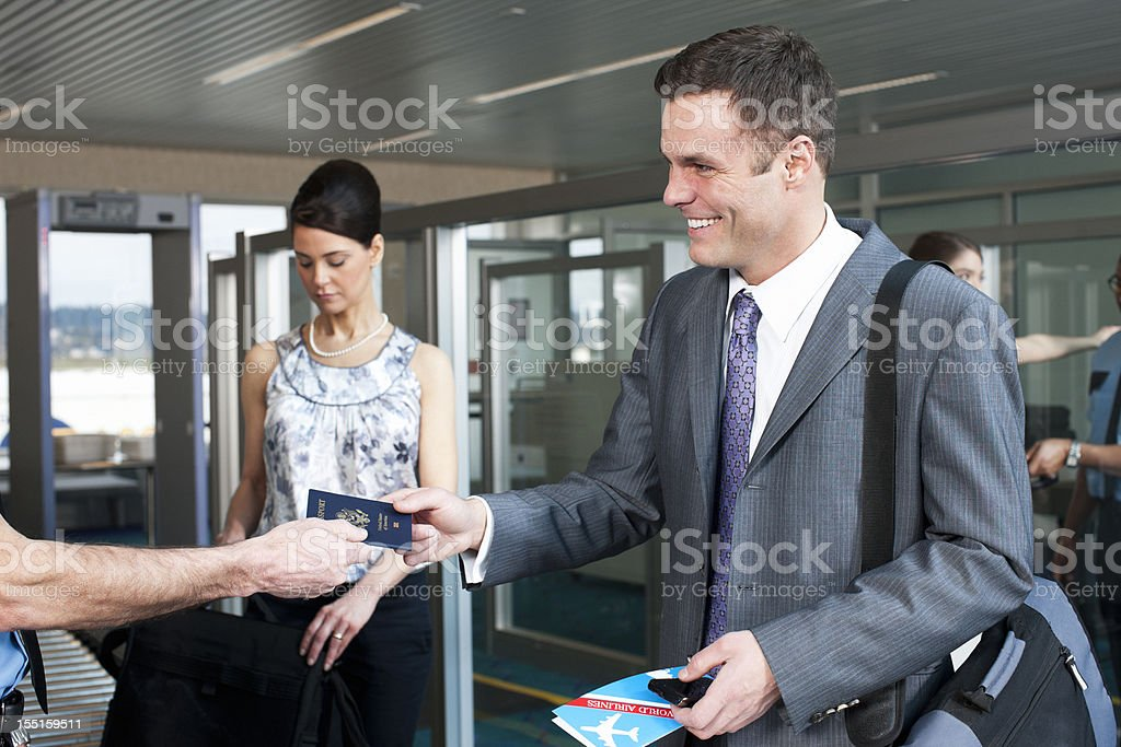 Airport Security, Smiling Businessman with Passport, Business Travel stock photo