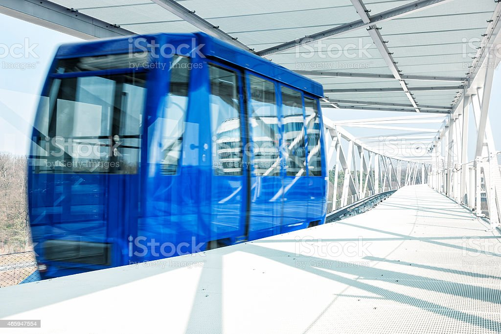 Airport Shuttle Train Pulling Into Modern Subway Station stock photo