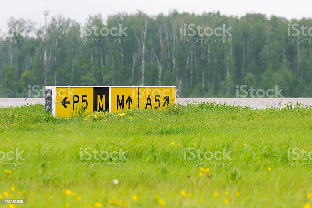 Airport sign pointer taxiways. stock photo