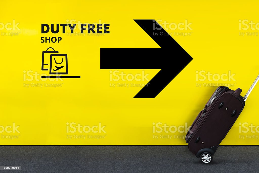 Airport Sign With Shopping Bag Icon, Arrow and moving Luggage stock photo
