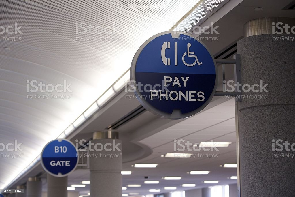 Airport Signs: Pay Phones and Gate royalty-free stock photo