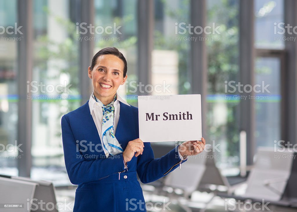 Airport stewardess to welcome Mr Smith stock photo