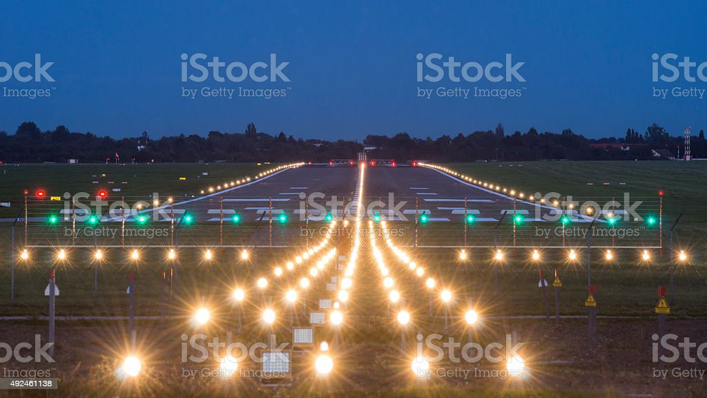 airport takeoff and landing area at evening stock photo