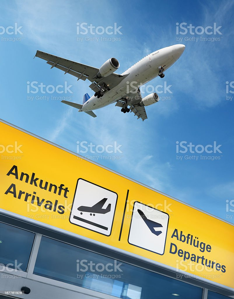 Airport terminal and flying airplane above royalty-free stock photo