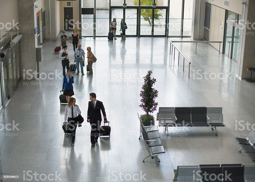Airport terminal building and travellers stock photo