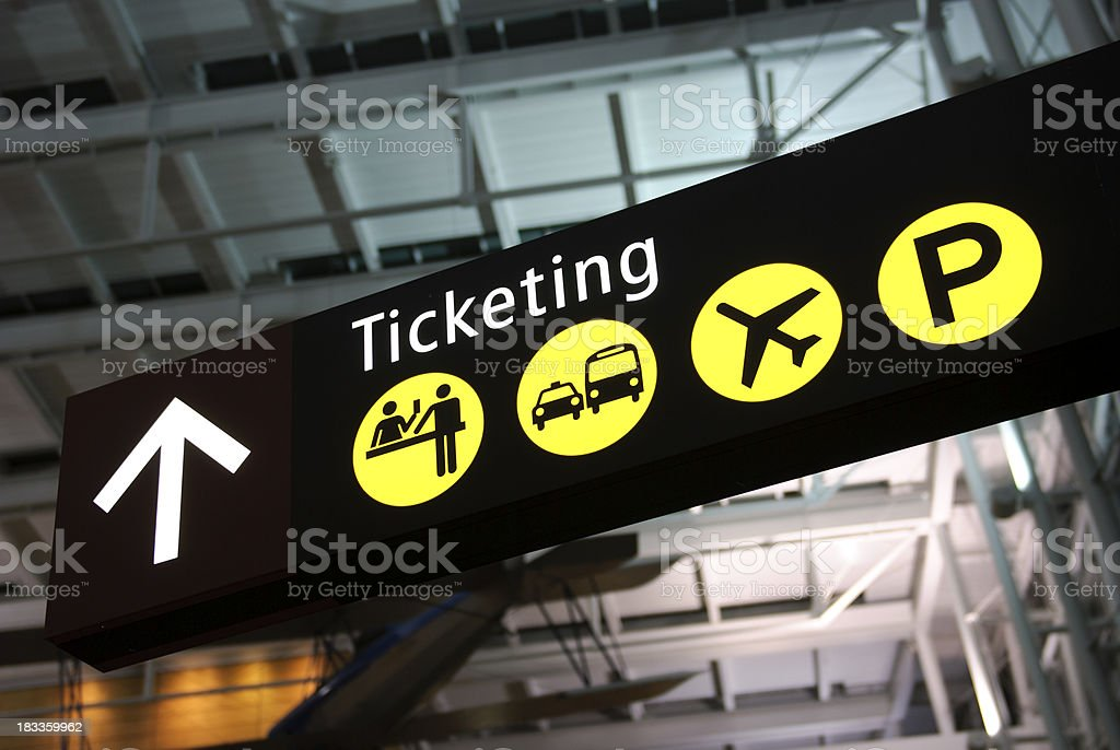 airport ticketing desk sign stock photo