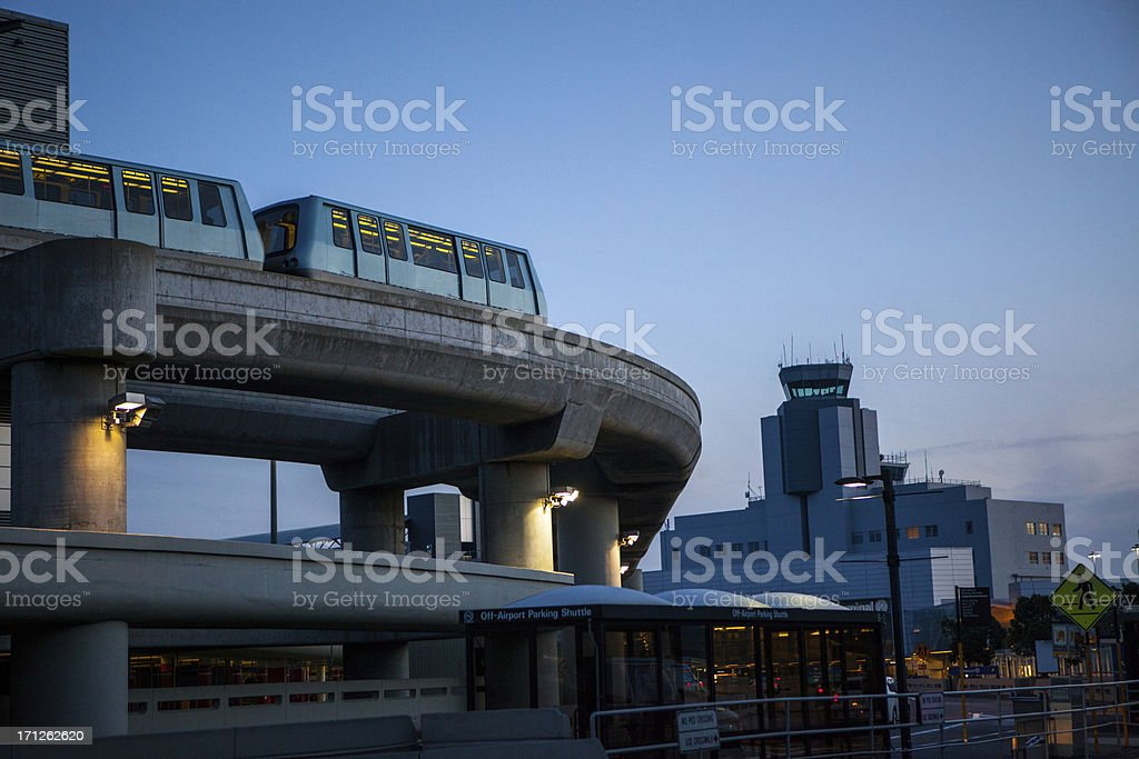 Airport tram at dusk stock photo