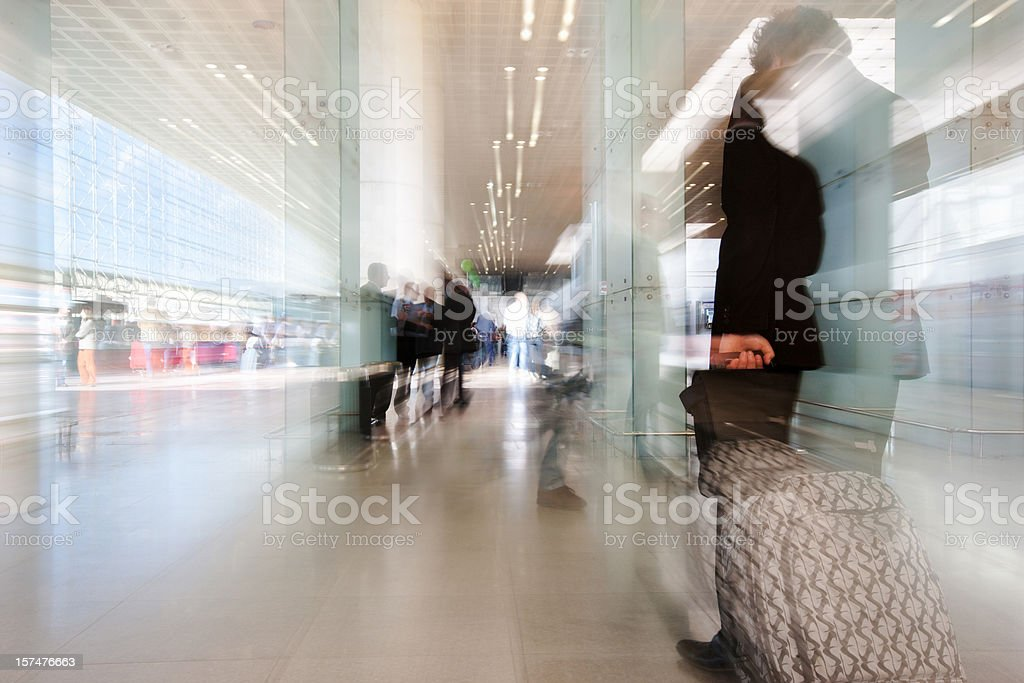 Airport Traveller pulling Trolley royalty-free stock photo